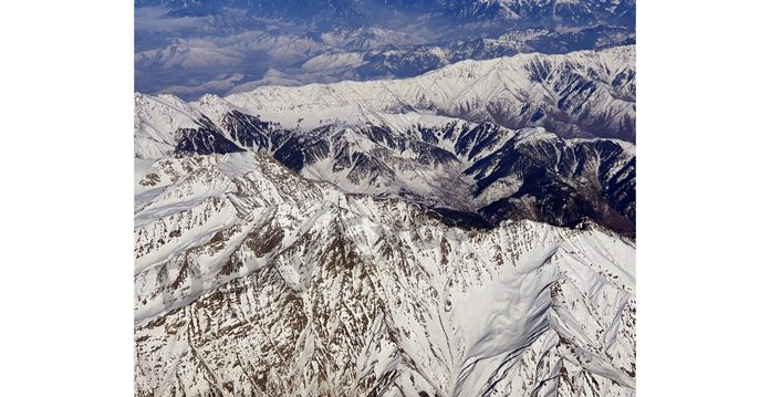 An aerial view of snow covered Pir Panjal range of Kashmir. — Excelsior/Aabid Nabi