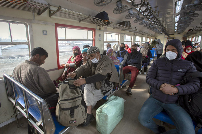 Passengers travelling in a train in Kashmir on Monday. —Excelsior/Shakeel