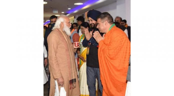 BJP president Ravinder Raina and national secretary Narinder Singh with Prime Minister Narendra Modi in New Delhi on Sunday.