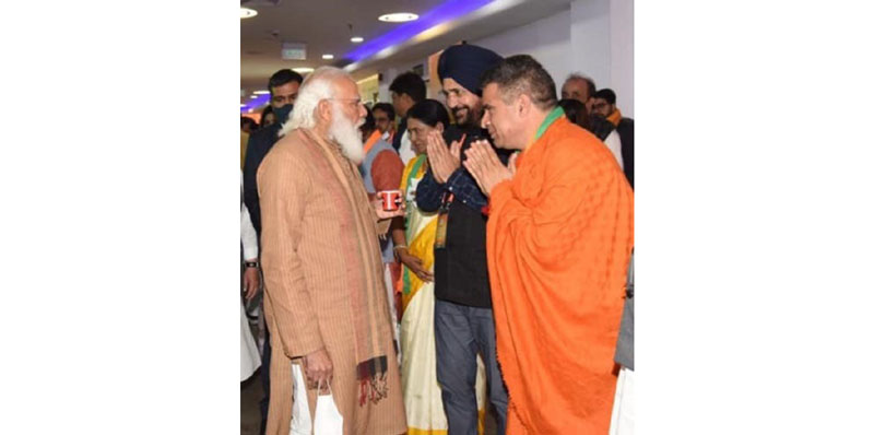 BJP president Ravinder Raina and national secretary Narinder Singh with Prime Minister Narendra Modi in New Delhi on Sunday.