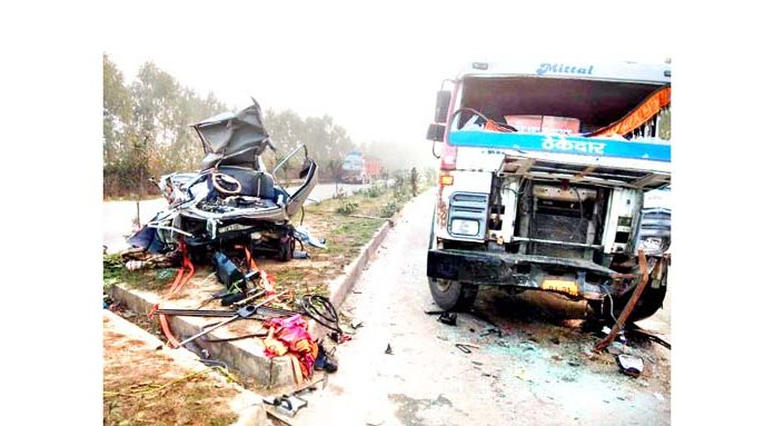 A van damaged beyond recognition after being hit by a Trailer near Mansar Morh in Samba on Saturday.