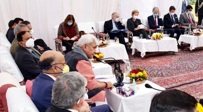 Lieutenant Governor Manoj Sinha interacting with foreign envoys at Raj Bhavan in Jammu on Thursday.