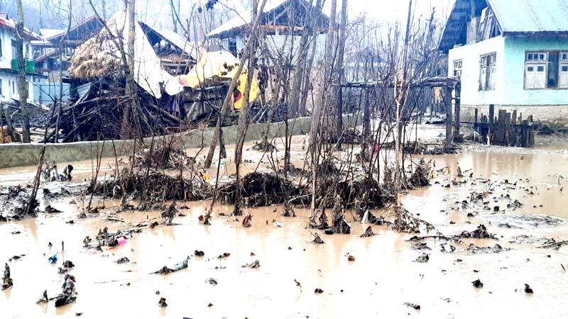 Incessant rains damage a house in Khahipora Rajwara area of Handwara.-Excelsior/Aabid Nabi