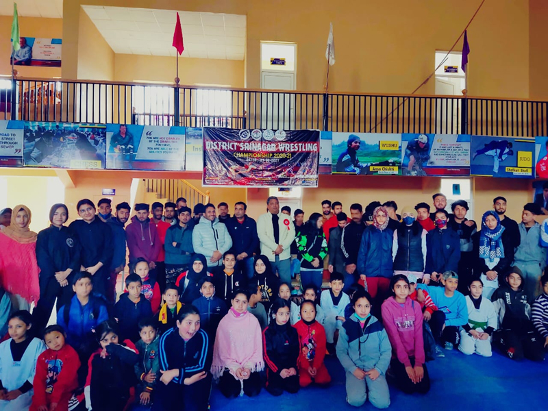 Former international wrestler, SSP Dushyant Sharma posing for group photograph with budding wrestlers at Srinagar.