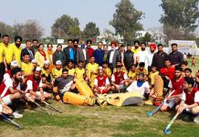 Winning teams posing for a group photograph with chief guest, Dr Saleem-Ur-Rehman during concluding ceremony of Hockey competition at Jammu.