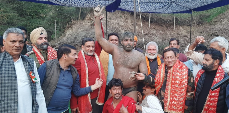 Winning wrestlers posing for a group photograph with dignitaries at Katra.