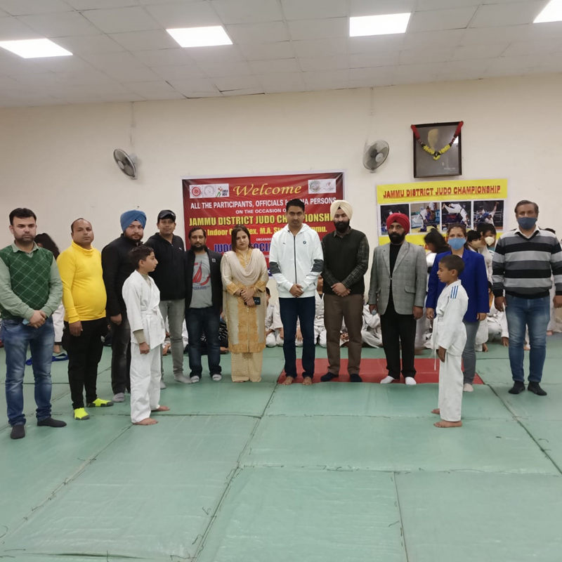 Dignitaries and players posing for a group photograph during Judo Championship at Jammu.