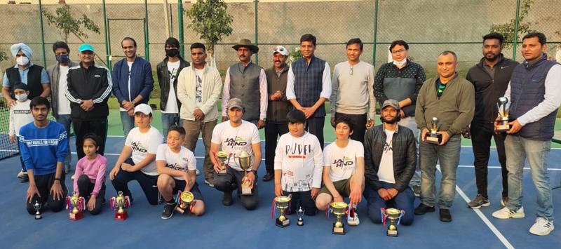 IGP Jammu Mukesh Singh posing along with other dignitaries during prize distribution of Lawn Tennis at Jammu.