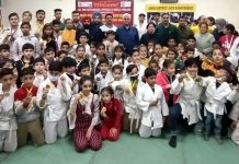 Winning Judo players posing a group photograph with dignitaries at Jammu.