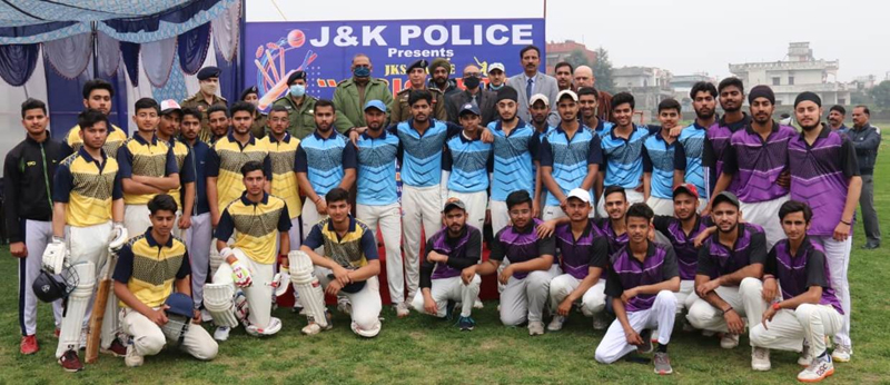 Winning team players posing for a group photograph with dignitaries at KC Sport Club Jammu.