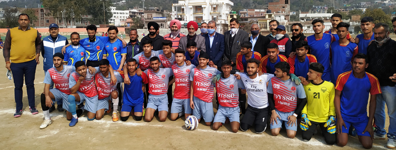 Winning players posing for a group photograph with dignitaries at Udhampur.