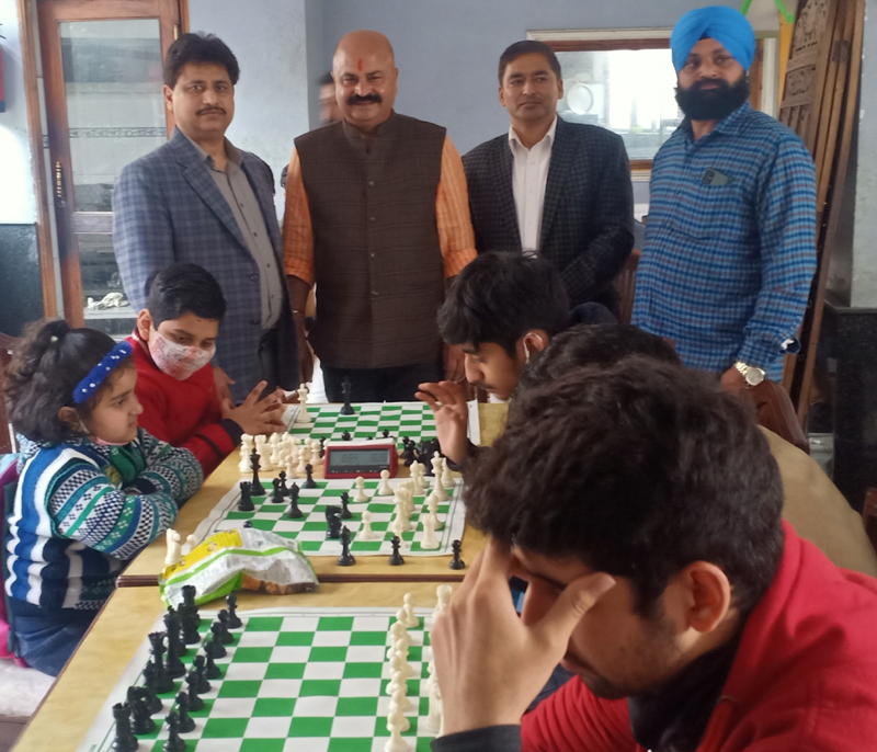 BJP leader Yudhvir Sethi along with Atul Gupta, president Chess Association of J&K watching a game at Jammu.