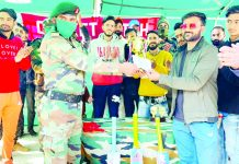Army officer presenting trophy to a player at Doda.