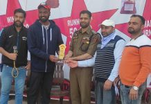 DySP Mumtaz Ali Bhatti presenting man of the match trophy to a player at Reasi on Wednesday.