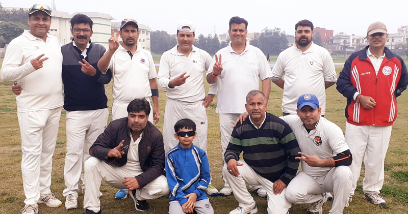 Winning team players displaying victory signs after the match at Jammu.