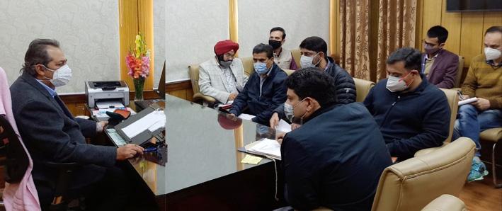 Advisor Baseer Khan chairing a meeting at Jammu on Monday.