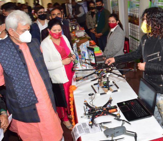 Lt Governor Manoj Sinha inspecting stalls demonstrated by the innovative farmers at SKUAST Jammu.