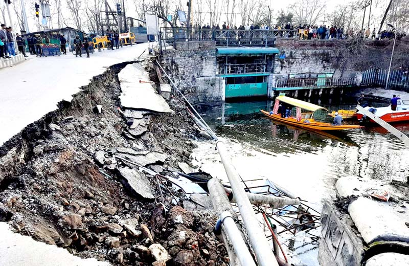 Portion of road caves in near Dalgate in Srinagar on Wednesday. -Excelsior/Shakeel