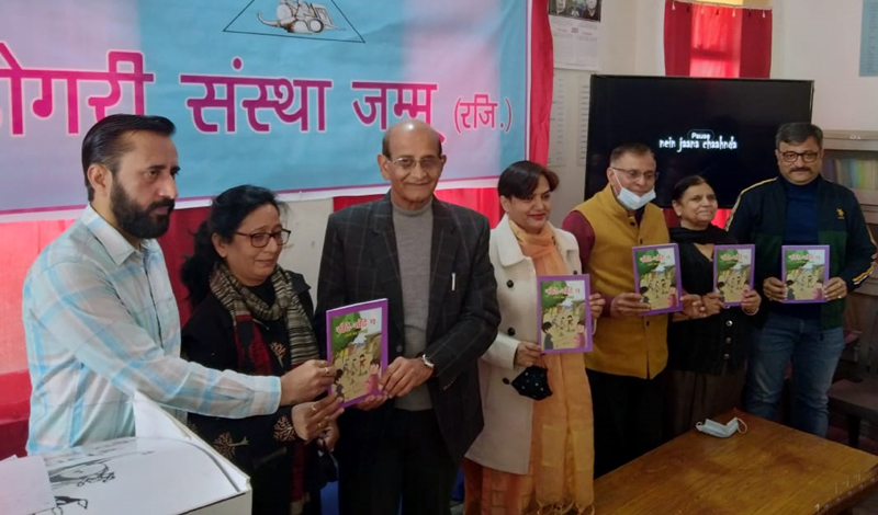 Director School Education Jammu and others releasing a children novel during function to celebrate Mother Tongue Day on Sunday.
