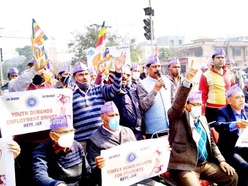 Confederation and DOM activists staging protest in Jammu on Sunday.