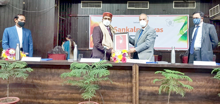 JU Vice-Chancellor Prof M K Dhar presenting memento to Capt Alok Bansal during a special lecture at Jammu University on Monday.