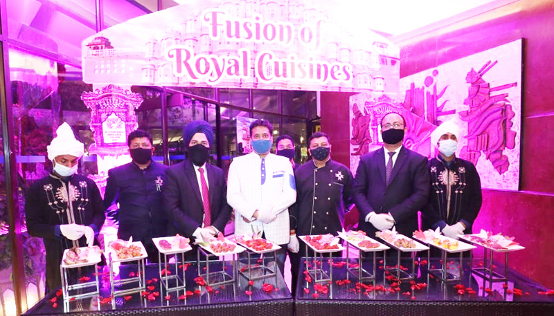 Officials and chefs showcasing cuisines to be served during 'Shahi Food Festival Fusion of Royale Cuisines' at Hotel KC Residency Jammu.