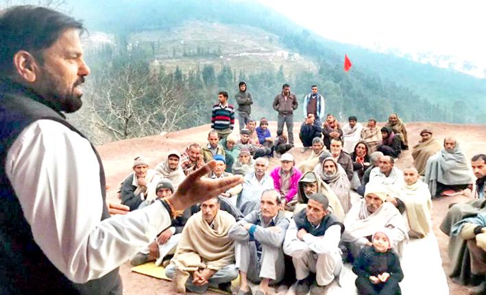 NPP leader Harshdev Singh addressing public meeting in Ramnagar on Monday.