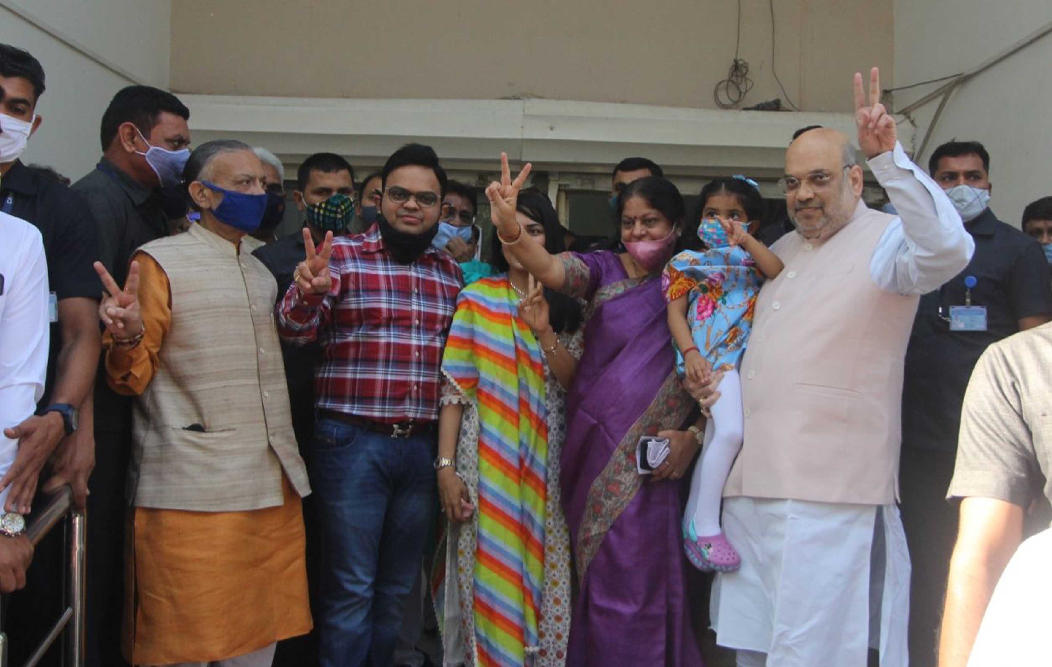 Union Home Minister Amit Shah coming out after casting vote for Ahmedabad Municipal Corporation election in Ahmedabad on Sunday. (UNI)