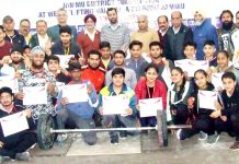 Medal winners of Weightlifting Championship posing for a group photograph with chief guest at Jammu on Friday.