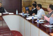 Principal Secretary, I&C R P Thakur chairing a meeting in Jammu on Thursday.