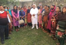 Former Minister Ajay Kumar Sadhotra posing for photograph with women leaders after the meeting.