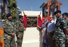 CRPF officers and parents during inauguration of memorial gate and statue of martyred soldier Ram Singh Salathia.