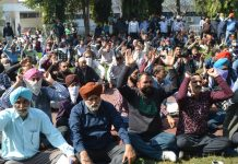JKRTC employees staging protest in Jammu on Thursday. — Excelsior/Rakesh