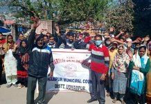 Safai Karamcharis raising slogans during protest demonstration at Udhampur on Thursday.