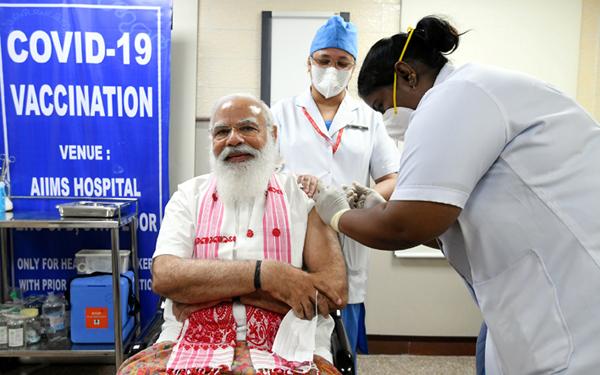 Prime Minister Narendra Modi takes his first dose of the COVID-19 vaccine at AIIMS in New Delhi on Monday.