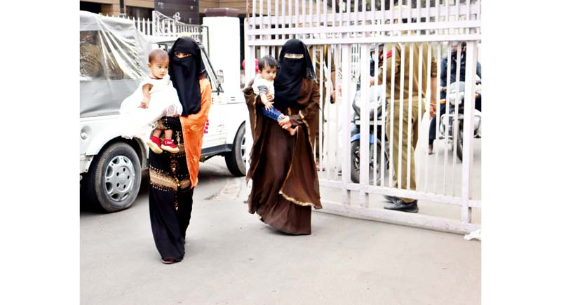 Rohingya women with their children outside MA Stadium in Jammu on Saturday. -Excelsior/Rakesh