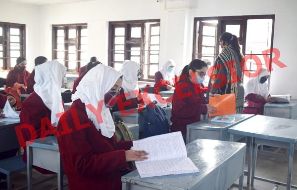 Students attend their class in a Srinagar school on Monday. — Excelsior/Shakeel