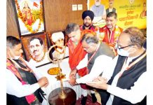 BJP national general secretary, Tarun Chug lighting a lamp as party's two-day meet begins at Katra on Saturday. -Excelsior/Romesh Mengi