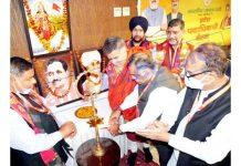 BJP national general secretary, Tarun Chug lighting a lamp as party's two-day meet begins at Katra on Saturday. -Excelsior/Romesh Mengi