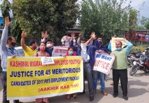Aggrieved PM Package candidates protesting near Press Club Jammu on Monday.