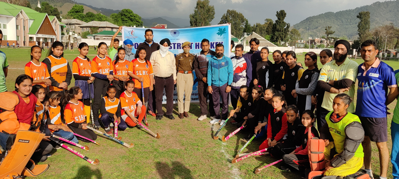 Sub Inspector, FJ Margray posing for a photograph with winning team at Poonch.