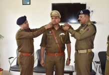 Officers decorating a Sub Inspector at PTS, Kathua on Monday. -Excelsior/Pardeep
