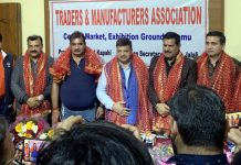 CCI Jammu office bearers posing together after honoured by TMA representatives.