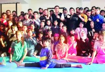 Selected Wushu players posing for a group photograph along with Dronacharya Awardee Kuldeep Handoo at MA Stadium Jammu.