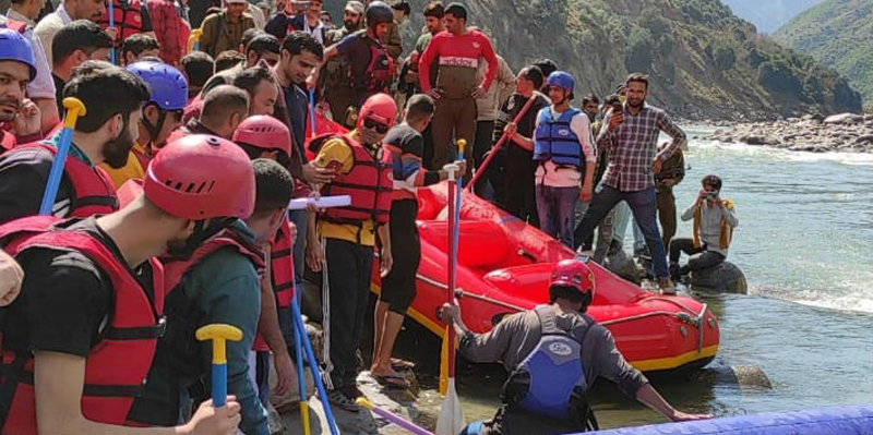 Participants taking part in Rafting festival in Chenab river at Doda on Friday.