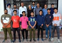 Selected Archery team posing for a group photograph with Divisional Sports Officer at MA Stadium Jammu.