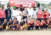 Councillor Cantonment Jammu, Pardeep Kour posing for a group photograph with winning team at Chatha Hockey Field.