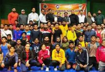 Winners of wrestling championship posing for a group photograph along with dignitaries at Jammu.