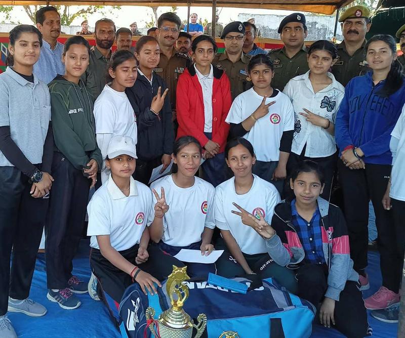 SSP Samba, Rajesh Sharma posing a photograph with winning women team at Samba on Friday.