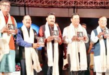 "Union Minister Dr Jitendra Singh and Chief Minister Assam Sarbananda Sonowal, along with other dignitaries, releasing the book titled ""Amit Shah : And the March of BJP"", at Guwahati on Monday."